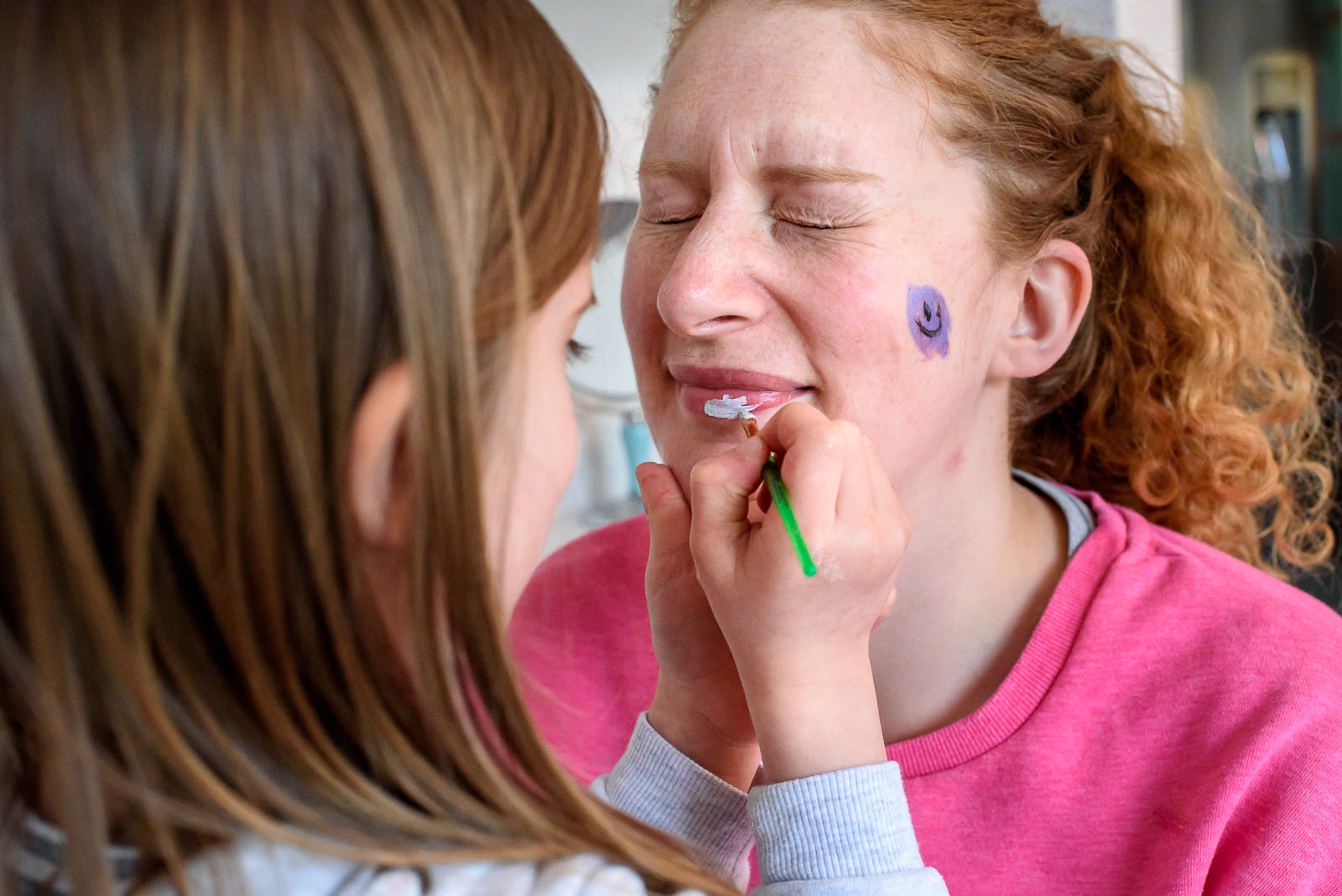 girl painting mums face