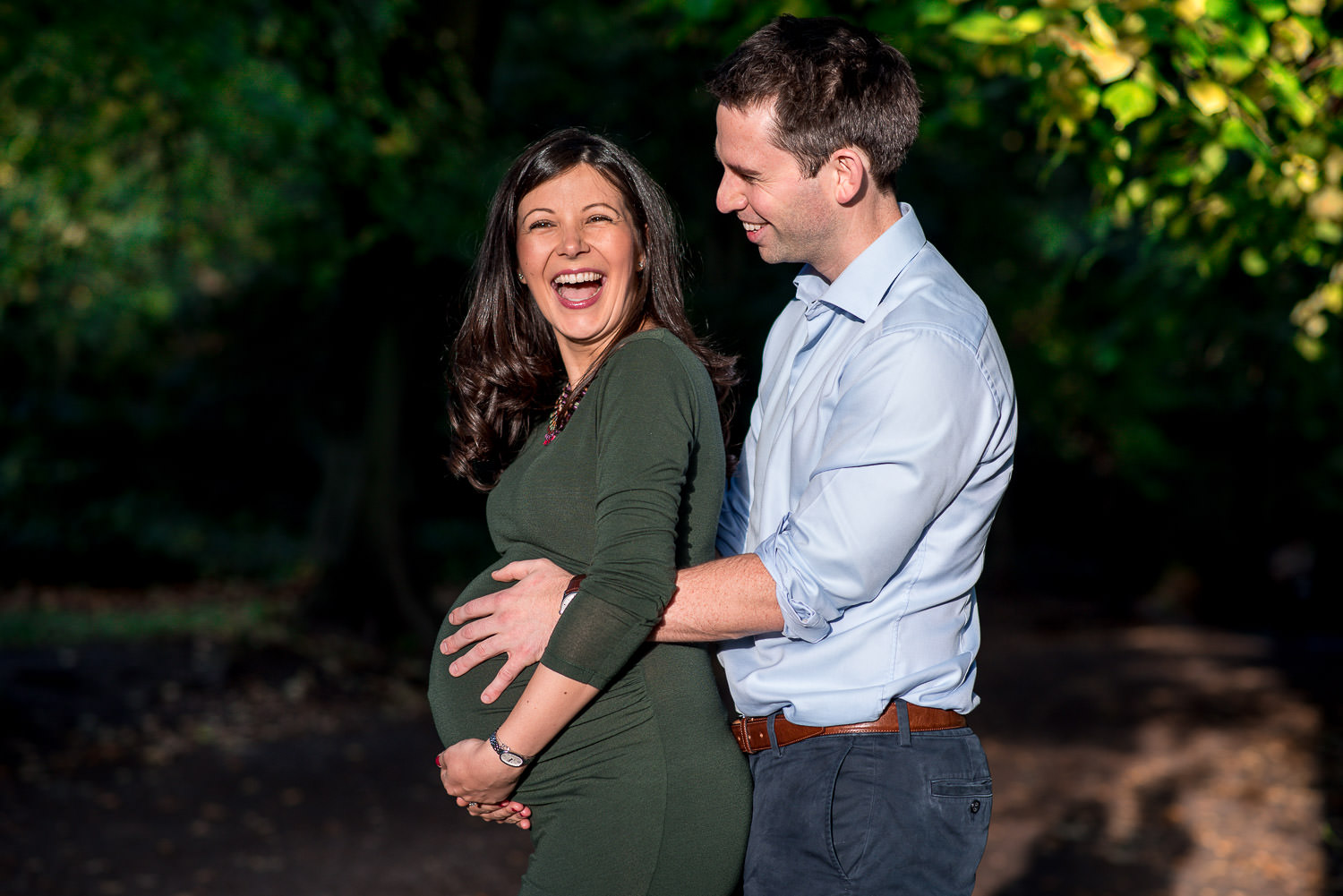 future parent laughing on maternity photo shoot