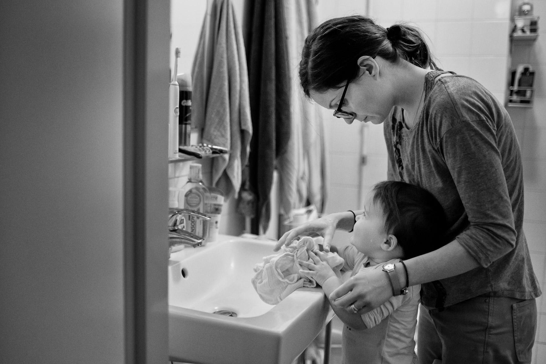mum washing daughter's hands