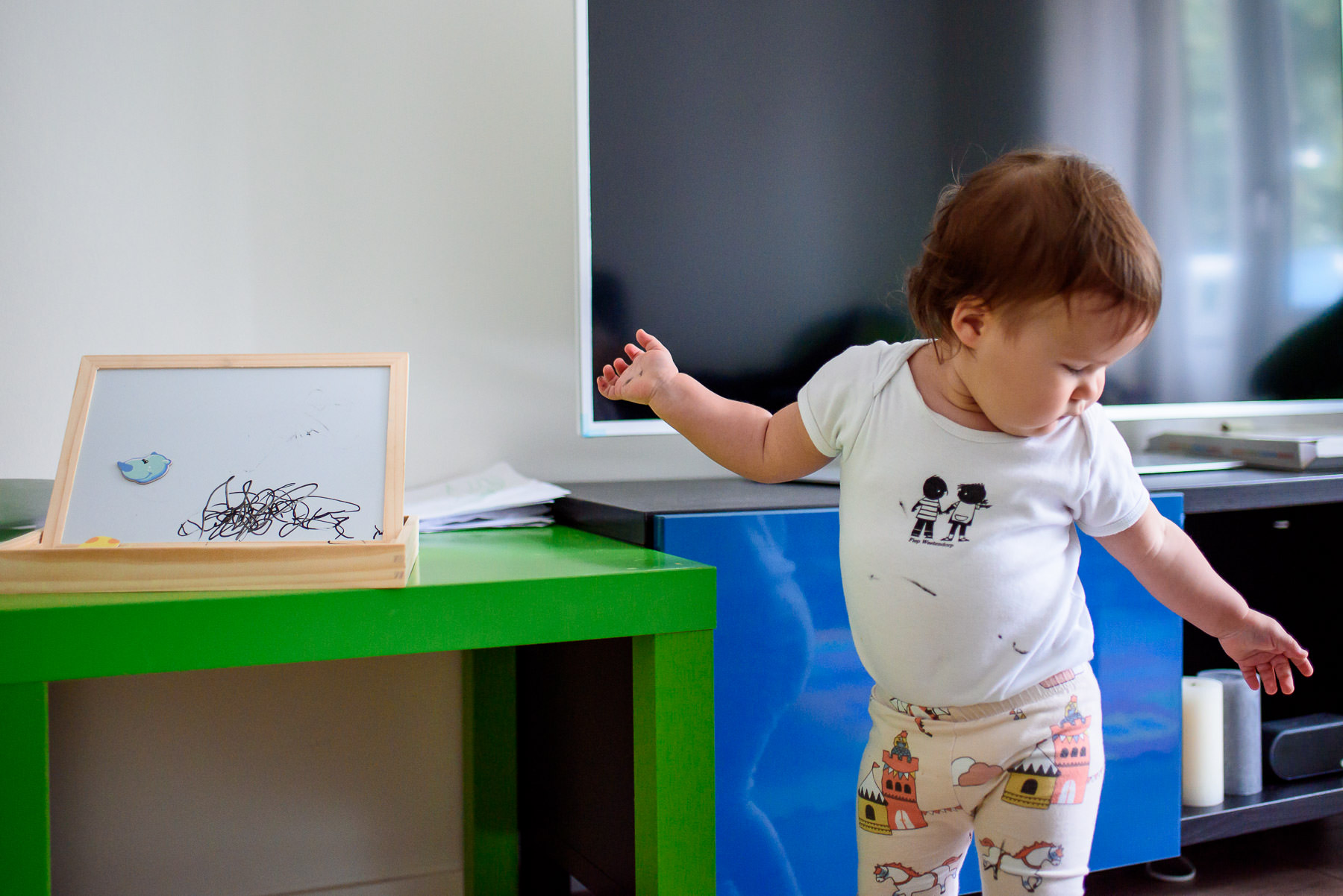 little girl dancing in the living room