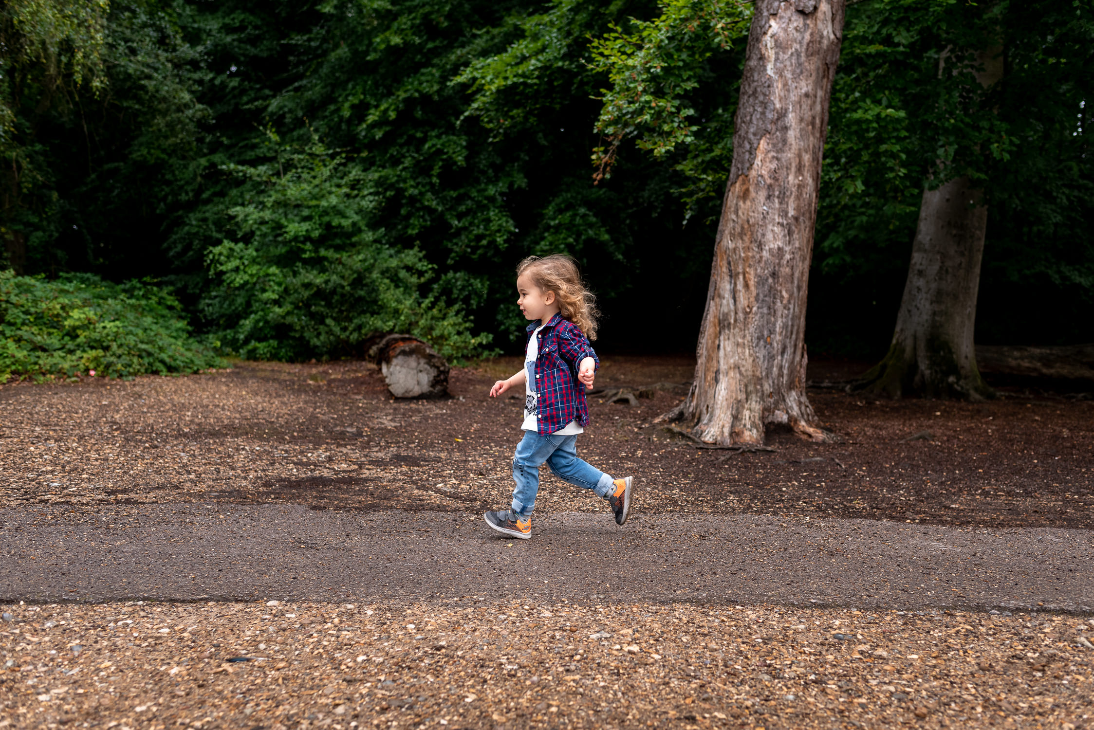Kid running on a trail in Black Park